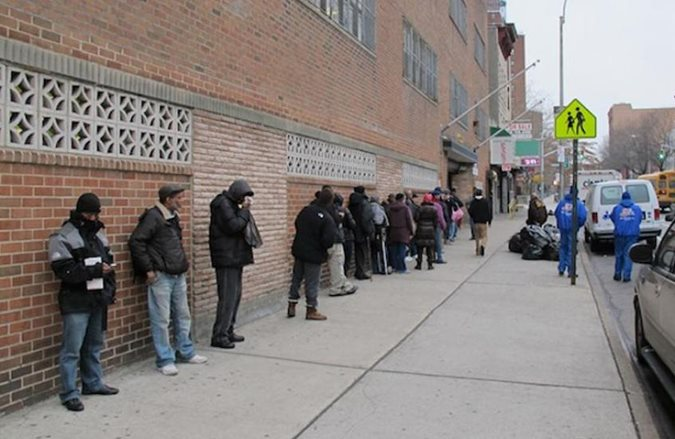 People waiting in line for food